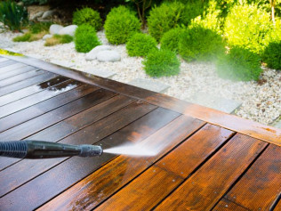 Pressure washing a deck in Evansville, IN